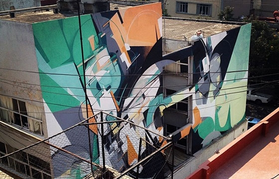 Kofie paints large building in Mexico City