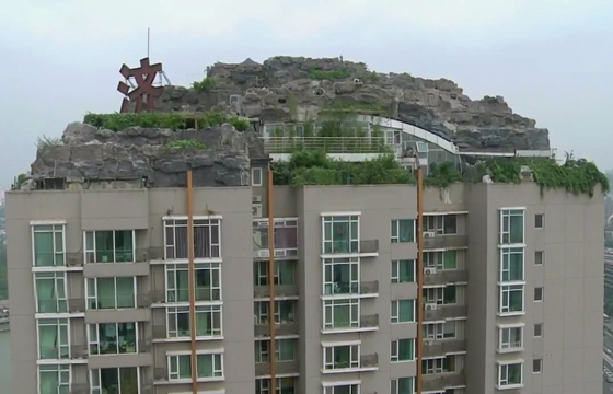 Man Builds Mountain Villa on Beijing Apartment Building